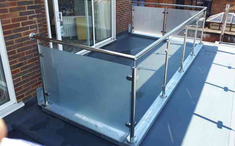 Etched privacy glass on stainless steel balustrade